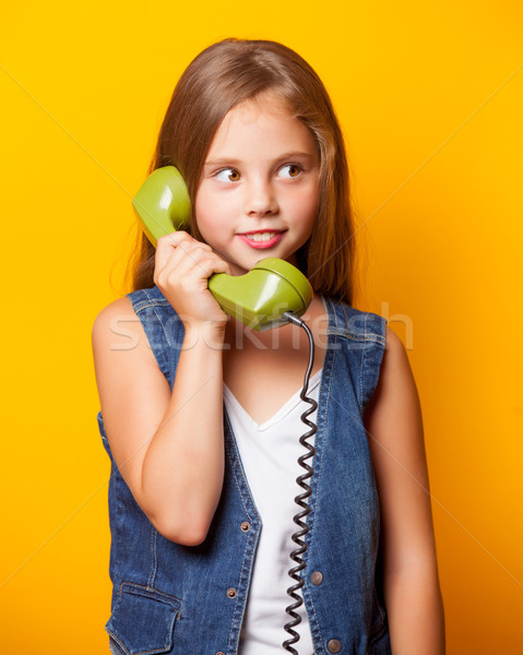 Young surprised girl with green handset Stock photo © Massonforstock