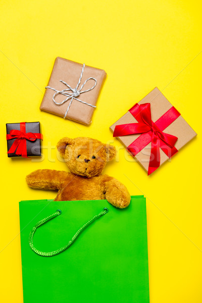 teddy bear in shopping bag and gifts Stock photo © Massonforstock