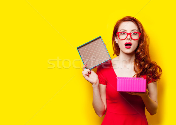 photo of beautiful young woman opening cute gift on the wonderfu Stock photo © Massonforstock