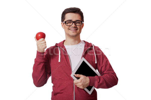 Young man with red apple Stock photo © Massonforstock