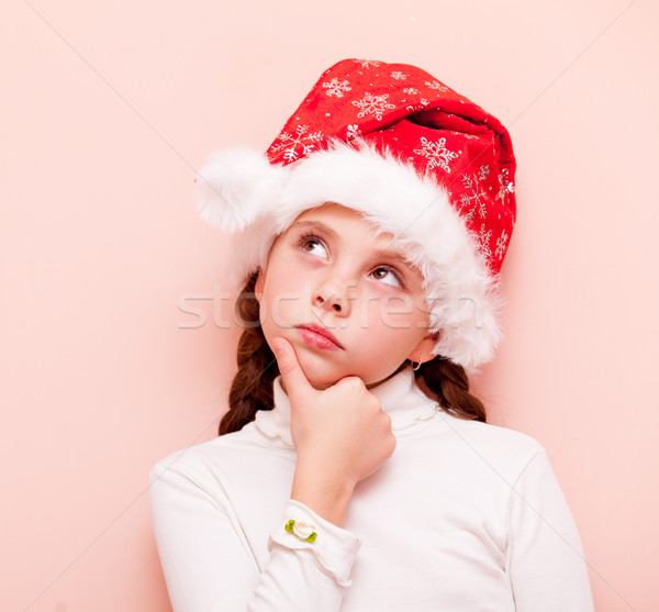 girl with pigtails in Santa Claus  Stock photo © Massonforstock