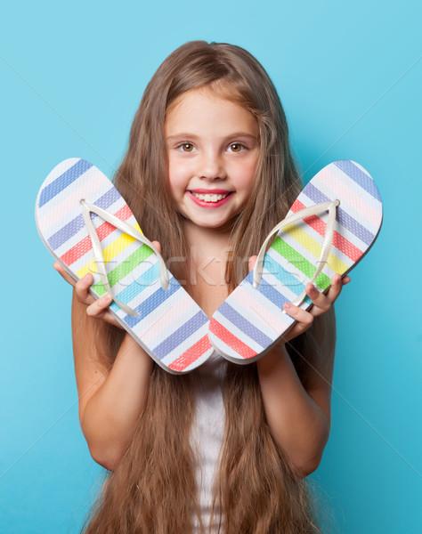 Fiatal mosolyog lány papucs kék nő Stock fotó © Massonforstock