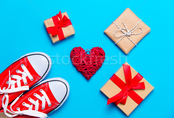 big red gumshoes, heart shaped toy and beautiful gifts on the wo Stock photo © Massonforstock