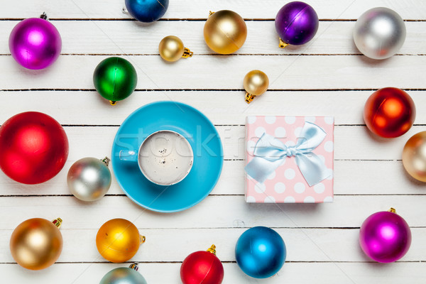 photo of blue cup of coffee and cute gift near colorful baubles  Stock photo © Massonforstock