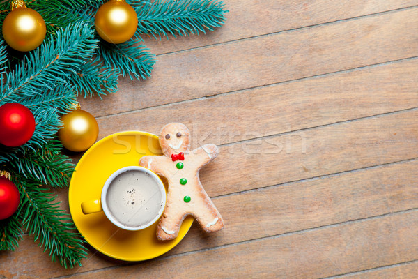fir tree branches, cup of coffee, gingerbread man and colorful b Stock photo © Massonforstock