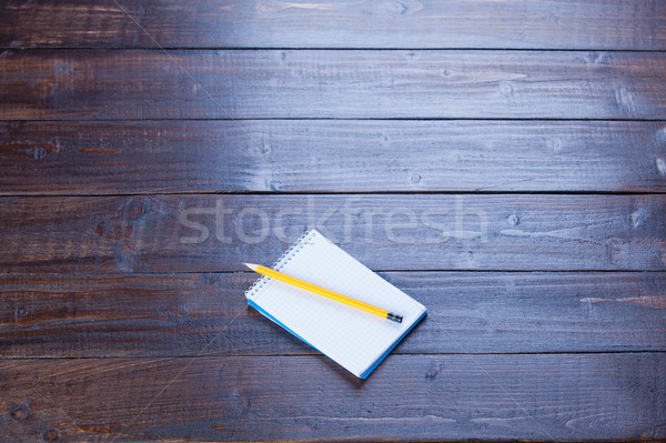 photo of opened copybook and pencil on the wonderful brown woode Stock photo © Massonforstock