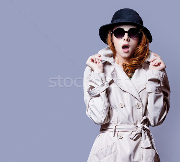 photo of beautiful surprised young woman on the wonderful grey s Stock photo © Massonforstock