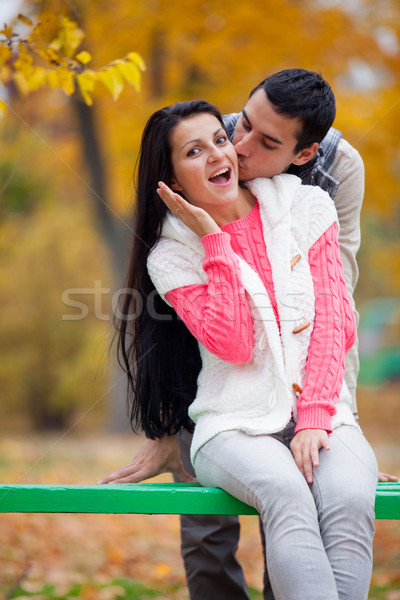 photo of man kissing his woman on the wonderful autumn trees bac Stock photo © Massonforstock