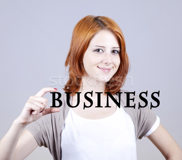 Red-haired businesswoman show abstract word 'businiess'. Stock photo © Massonforstock