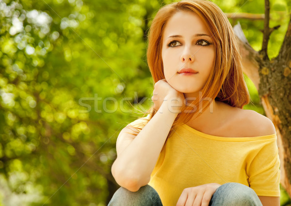 Redhead girl at summer park. Stock photo © Massonforstock