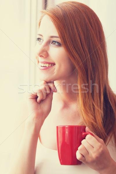 Belo mulher jovem copo janela café cidade Foto stock © Massonforstock