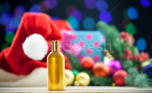 Parfüm şişe Noel ışıklar şapka beyaz Stok fotoğraf © Massonforstock