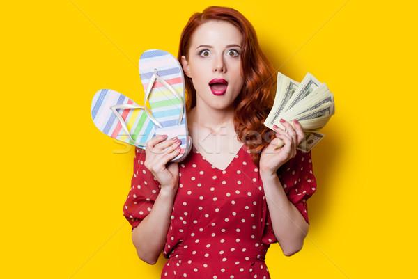 Lány vörös ruha papucs pénz meglepődött vörös hajú nő Stock fotó © Massonforstock