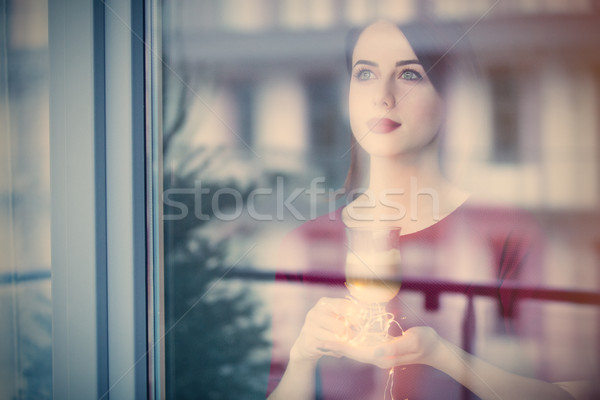 Beautiful rednead woman with cup of coffee or cappuccino near a  Stock photo © Massonforstock