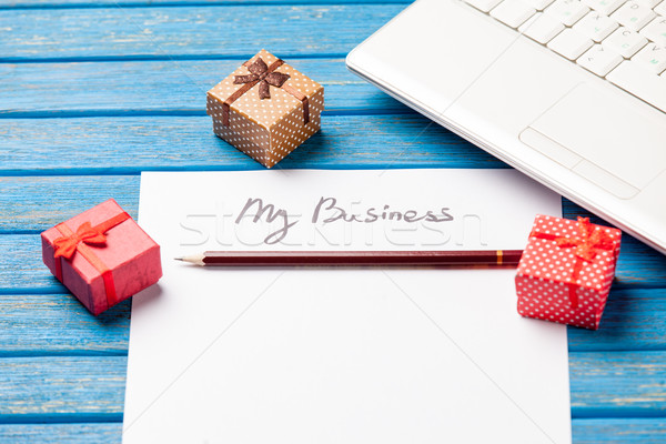 photo of paper My business, laptop and cute gifts on the wonderf Stock photo © Massonforstock