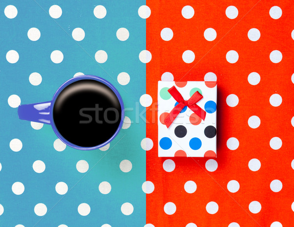 photo of cup of coffee and cute gift on the wonderful colorful d Stock photo © Massonforstock