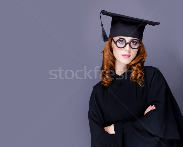 photo of beautiful young alumnus in black suit on the wonderful  Stock photo © Massonforstock