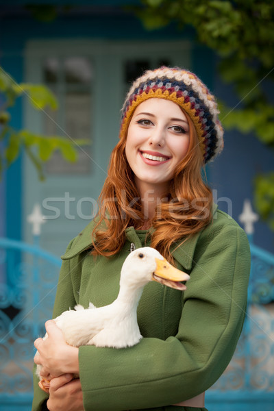 photo of beautiful young woman with goose on the wonderful build Stock photo © Massonforstock