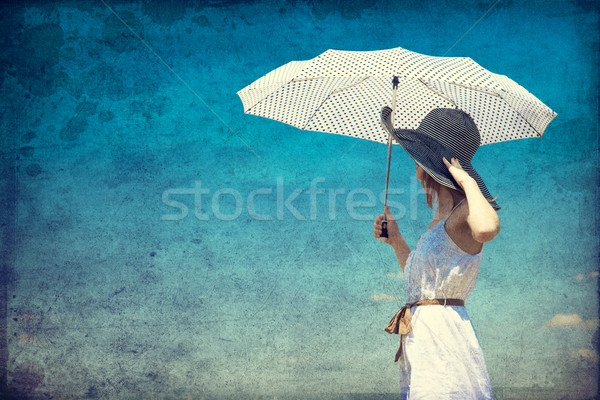 Redhead girl with umbrella at outdoor. Stock photo © Massonforstock