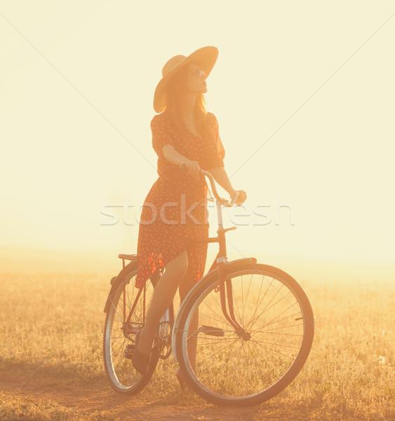 Ragazza bike campagna sunrise tempo strada Foto d'archivio © Massonforstock