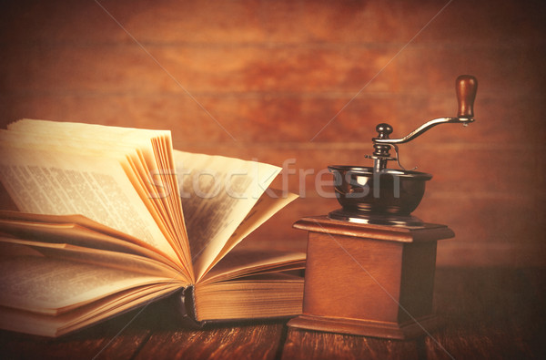 Coffee gringer and ropened book  Stock photo © Massonforstock