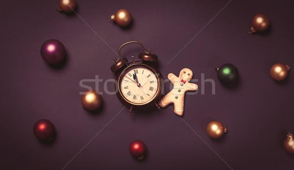 Alarm clock and gingerbread man Stock photo © Massonforstock