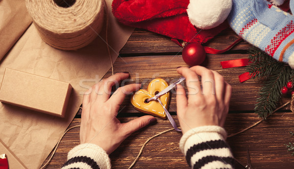 Woman wrapping a christmas cookie Stock photo © Massonforstock