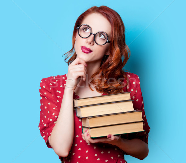 girl in red dress with books Stock photo © Massonforstock