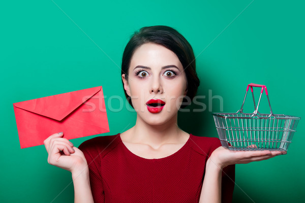 woman with red envelope and shopping basket  Stock photo © Massonforstock