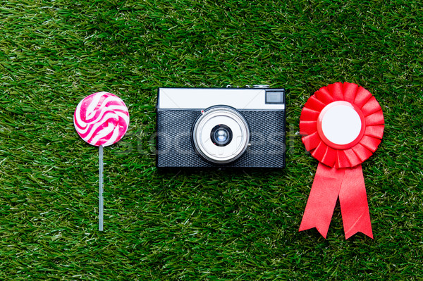 Red reward and vintage camera with lollipop Stock photo © Massonforstock