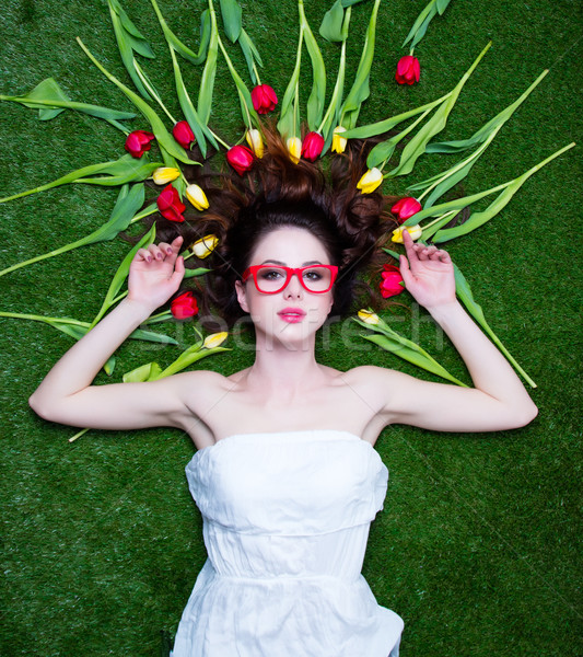 Portrait of a young redhead woman with tulips and glasses Stock photo © Massonforstock