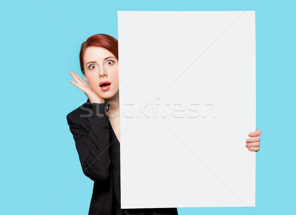 beautiful surprised young woman with big empty poster on the won Stock photo © Massonforstock
