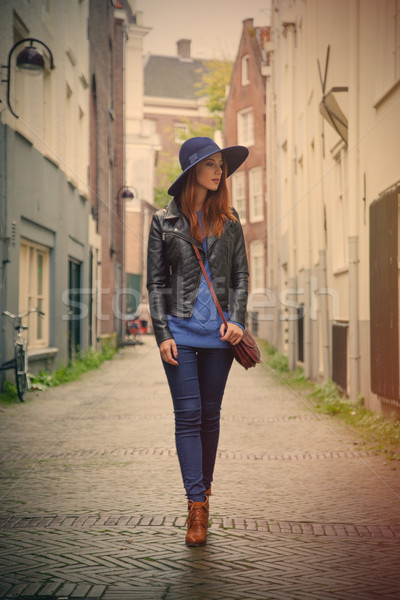 beautiful young woman walking on the street and exploring the to Stock photo © Massonforstock