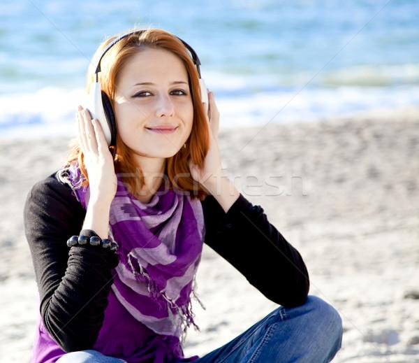 Retrato menina fone de ouvido praia boné mulher Foto stock © Massonforstock