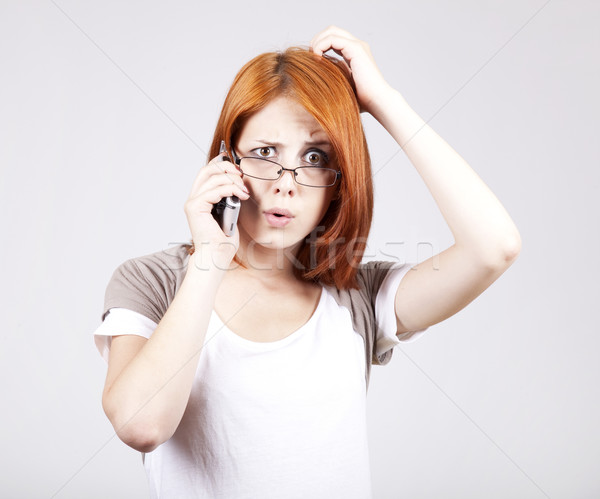 Young Businesswomen in white speaking by mobile phone. Stock photo © Massonforstock