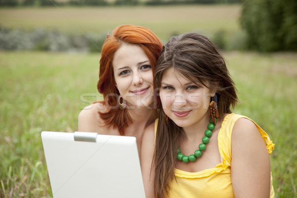 Two beautiful girls with notebook Stock photo © Massonforstock