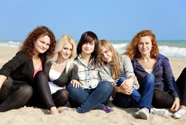 Five girls at outdoor near beach Stock photo © Massonforstock