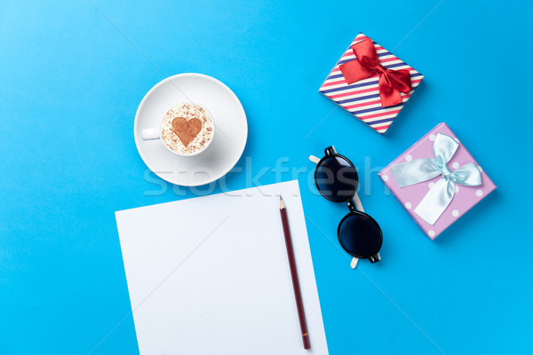 paper, cup, glasses and gifts lying on the table Stock photo © Massonforstock