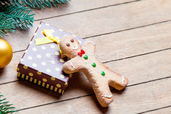 gift, gingerbread man and fir tree branch with bauble on the won Stock photo © Massonforstock