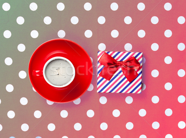 photo of cup of coffee and cute gift on the wonderful pink dotte Stock photo © Massonforstock
