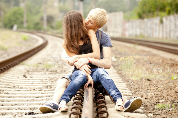 Couple kissing at railway. Urban photo. Stock photo © Massonforstock