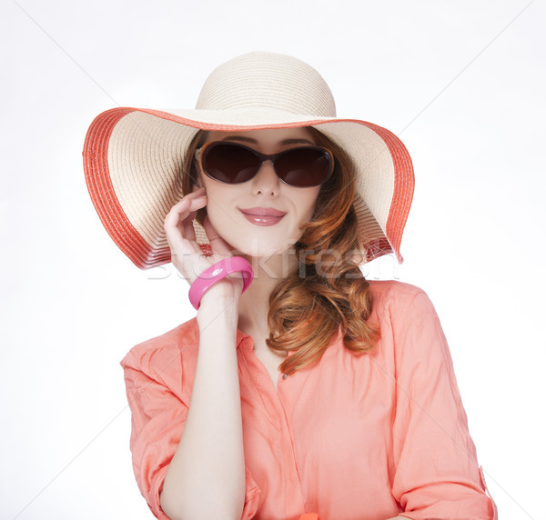 Beautiful red-haired girl in hat at white background Stock photo © Massonforstock