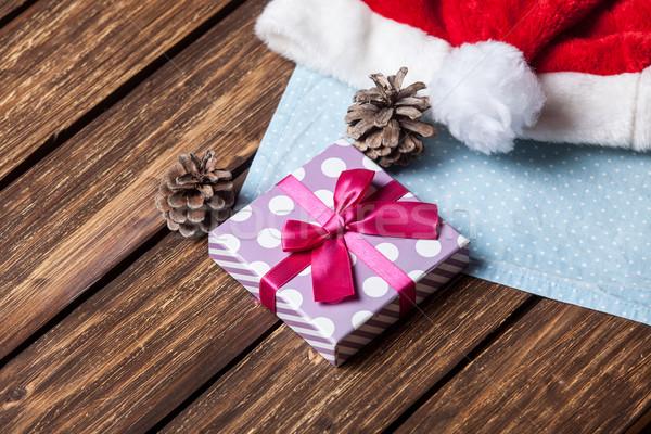 Santas hat and gift  Stock photo © Massonforstock