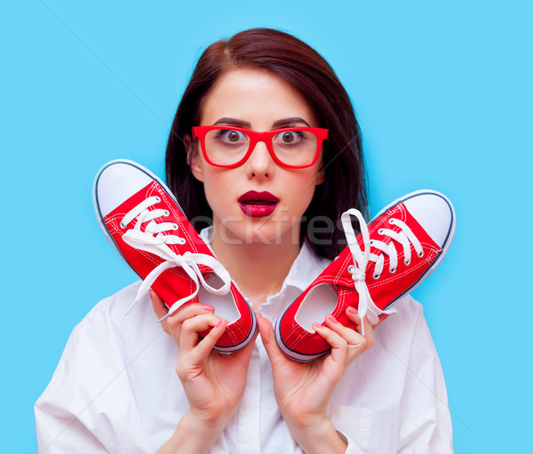 portrait of a young woman with gumshoes Stock photo © Massonforstock