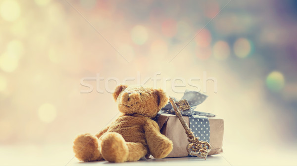 cute teddy bear, golden key and beautiful gift on the fairy ligh Stock photo © Massonforstock