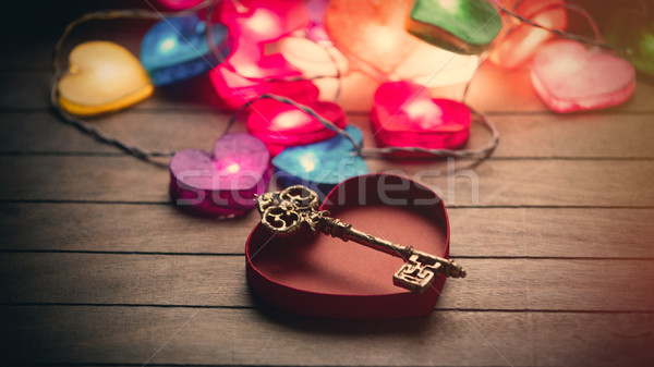 beautiful colorful heart shaped garland, golden key and opened h Stock photo © Massonforstock
