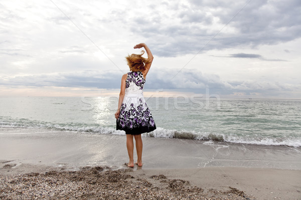 Young girl in sundress on the beach. Stock photo © Massonforstock