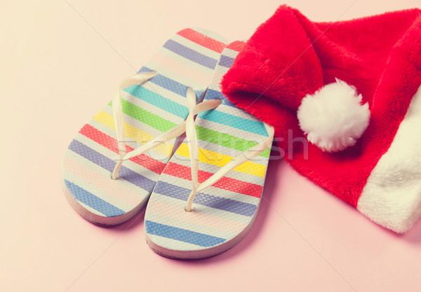 Santas hat and flip flops Stock photo © Massonforstock