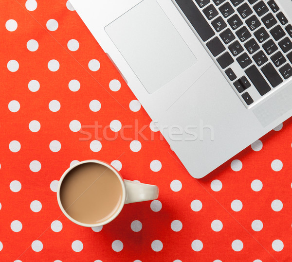 Cup of coffee and laptop computer  Stock photo © Massonforstock