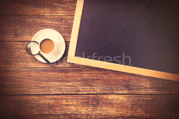 Cup of coffee with loupe and blackboard  Stock photo © Massonforstock